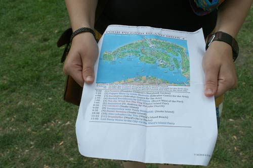 Vanessa holds the map and schedule